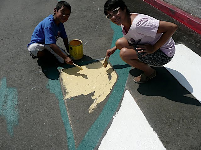 Adonia and a youth whose name I can't remember (sorry) putting down our new crosswalks - photo by Kathy