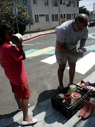 We had a lot of help from the youth of the neighborhood - Jennifer (in red) did a lot of great work - Photo by Kathy