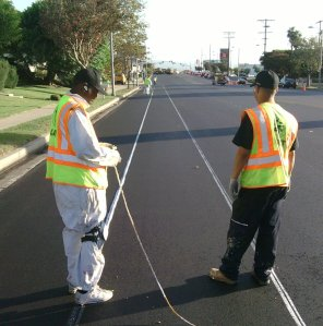 City workers putting preliminary markings on bike lane