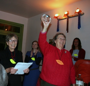 Honored guest Jackie Goldberg holds clock plaque award up