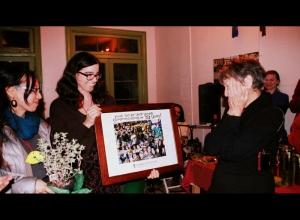 Yuki Kidokoro and Becca L present congratulatory photo collage to a speechless Lois Arkin